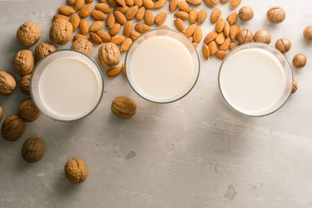 Glasses of milk: Macadamia, almond, walnut. Top view.