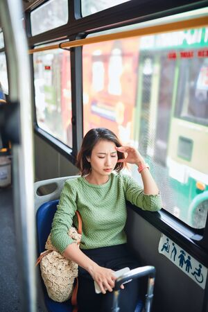 Passenger traveling and feeling dizzy with headache in a bus travel
