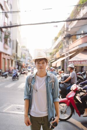 Male tourist backpackers travel summer traveler holidays in the city.