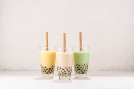 Various Bubble Tea in glasses with drink straws on white background Stockfoto