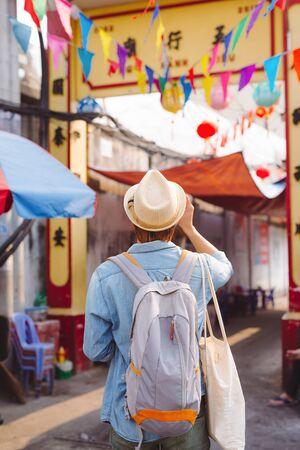 Young Asian man traveler and photographer with jean shirt and hat taking photos Stock fotó