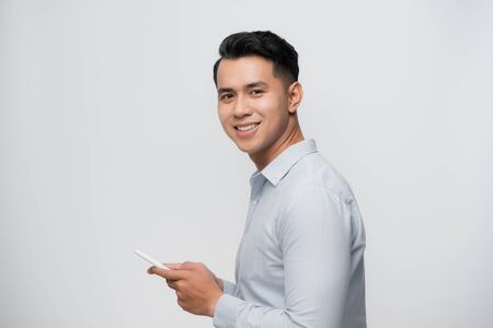 Happy smile face of handsome Asian man use smartphone. Stock Photo