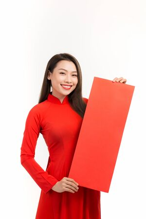 Young asian woman showing Spring festival couplets for lunar new year