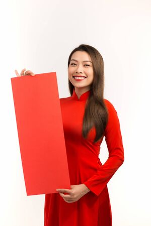 Happy lunar new year. Beautiful asian woman with congratulation gesture