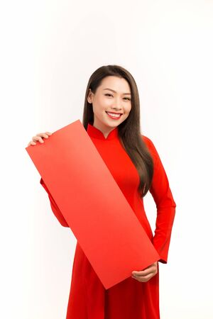 Happy Tet holiday (chinese new year). Smiling asian woman holding blank red couplets