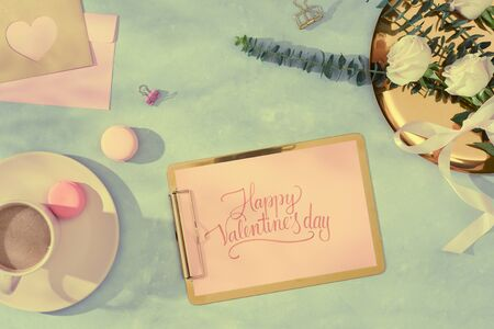 flat lay composition with flowers, a cup o coffee and sweets. Concept valentines day top view