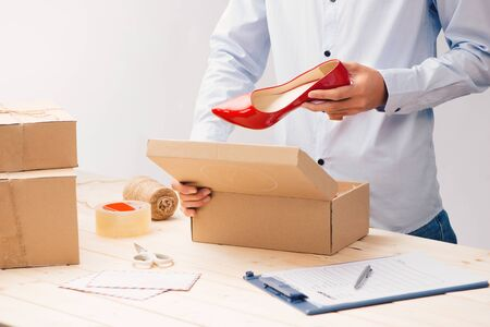 Young business owner packing cardboard box. about shopping online.