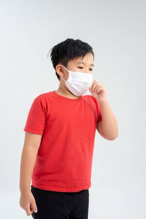 Portrait of Asian little boy wear healthcare mask and cough. Medical and healthcare concept