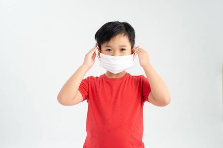 Portrait of a boy wearing a medicine healthcare mask.