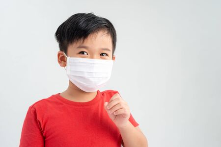 Portrait of a boy wearing a medicine healthcare mask and caught