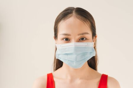 Woman wearing face mask protect filter pm2.5 anti pollution, anti smog and viruses. Air pollution, environmental concept.