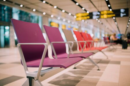 Empty seats at the departure gates for international flights at the Changi International Airport. Stock Photo