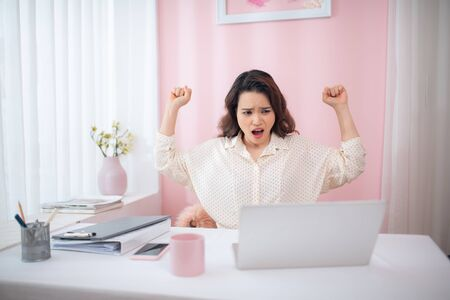 Businesswoman yawning while sitting in office