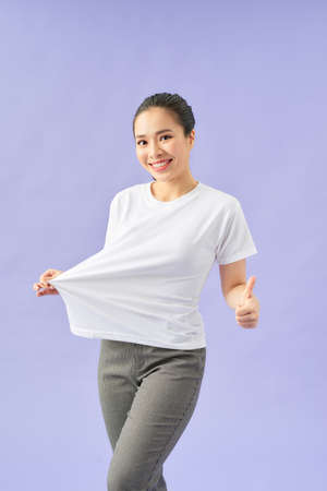 Happy young woman after weight loss.