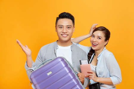 Happy couple with suitcases and passport