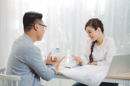Female Real Estate agent offer home ownership and life insurance to her client.