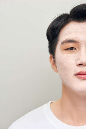 man with a mud mask on his face
