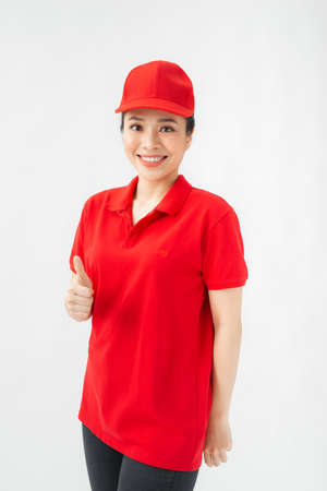 A portrait of Happy Female delivery service showing thumb up