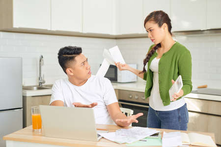 Woman and man arguing about money at home. Problems in relationship