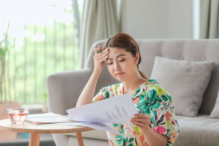 Attractive asian woman doing homework at home Standard-Bild