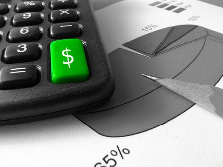 a big green key of a calculator with a dollar sign on a black and white photo with the tip of a pencil over a pie chart