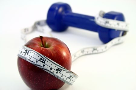 a red apple with a measuring tape wrapped around it in front of a blue dumbbell, isolated in white