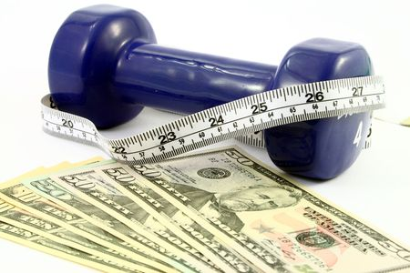 several bills of american dollars in front of a blue dumbbell wrapped with a measuring tape