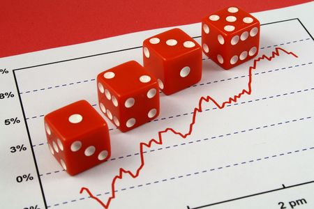 Four red dice over a stock market graph Stock Photo