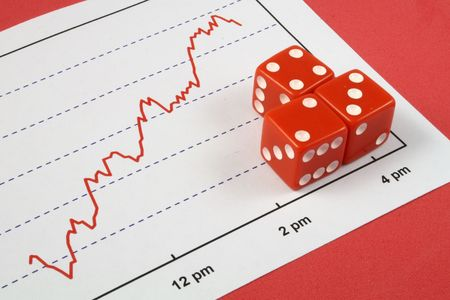 three red dice over a stock market graph Stock Photo