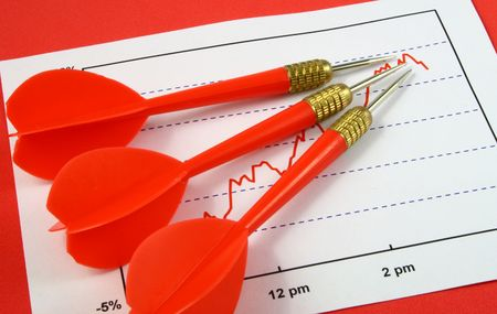 three darts pointing to the highest point in a line graph Stock Photo