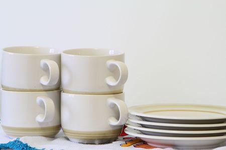 arranged: teacup set neatly arranged
