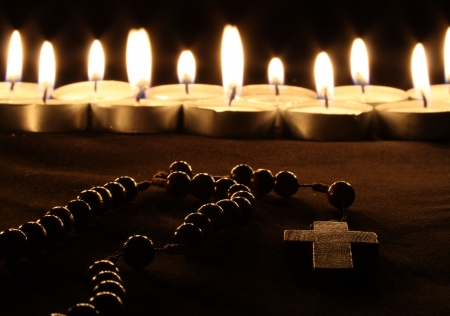 crist: a crucifix in front of a row of candles