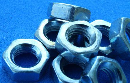 close up on bolts on under blue light Stock Photo - 2482568