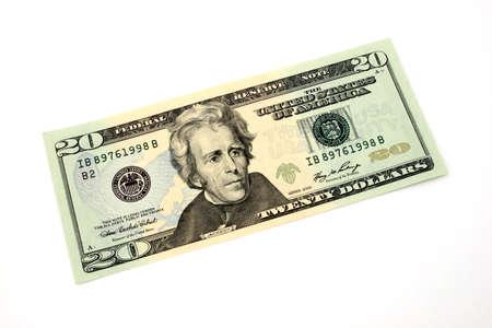 twenty dollar bill over a white surface photo