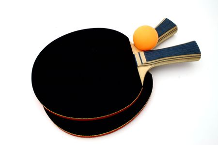 ping pong  paddles and an orange ball over a white surface
