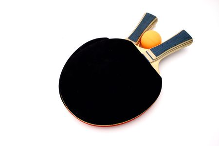 ping pong: ping pong  paddles and an orange ball over a white surface