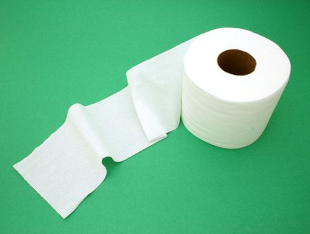 ply: roll of toilet paper over a green surface