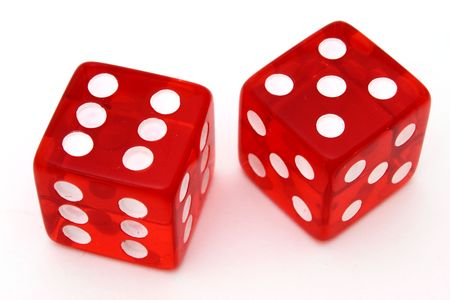 pair of red dice on a white surface