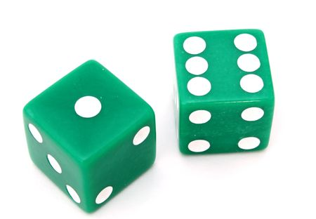pair of green dice on a white surface Stock Photo