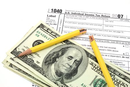 broken yellow pencil over dollars and 1040 tax form
