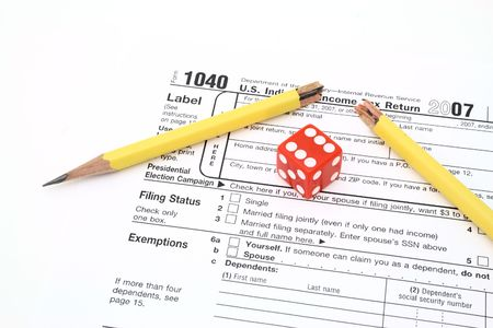 red die and broken pencil over 1040 tax form Stock Photo - 2666556