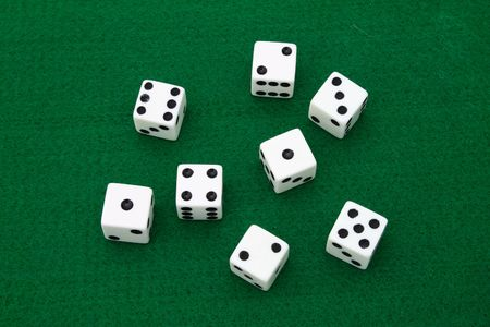 several dice over a green table