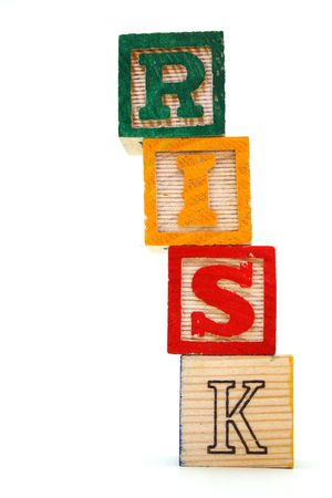word risk made with toy blocks on a white background
