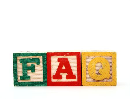 alphabet wood blocks over a white surface forming the word faq photo