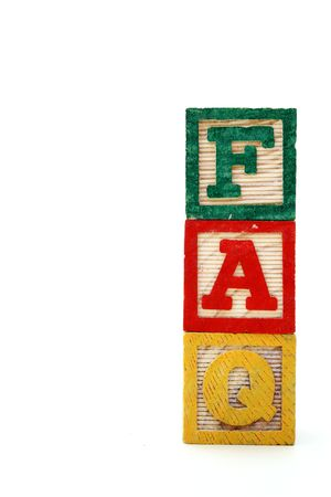 letter wood blocks forming the word faq in the vertical photo