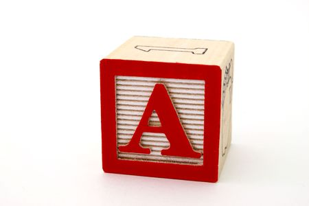 letter a in a alphabet wood block on a white surface Stock Photo - 2782669