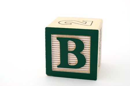 letter b in a alphabet wood block on a white surface