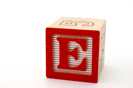 wood block: letter e in a alphabet wood block on a white surface Stock Photo
