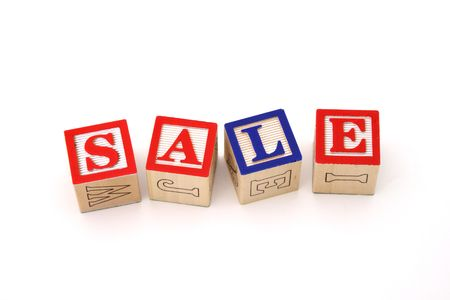 alphabet wood blocks forming the word sale on a white surface photo