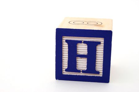 block letters: letter h in a alphabet wood block on a white surface